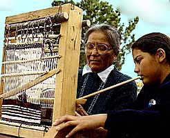 Granddaughter Learns to Weave Navajo Rugs from Elder
